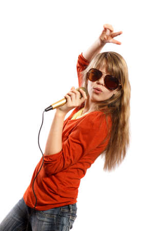 Teenagers girl singing into a microphone on a white background Stock Photo