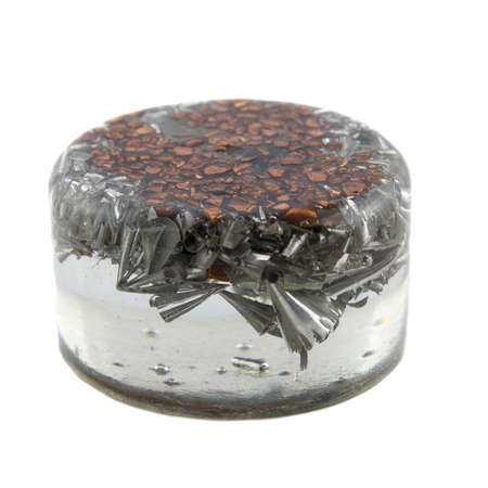 ions: esoteric orgonite is a crystal generator that turns negative ions into positive ions Stock Photo