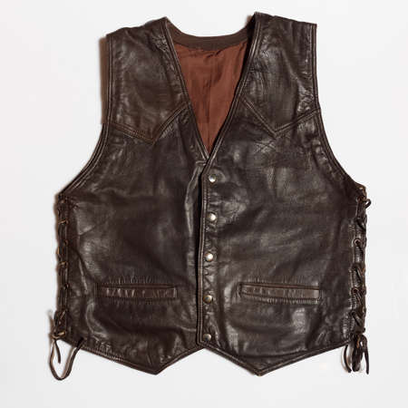 Vintage biker mans leather waistcoat on a white background