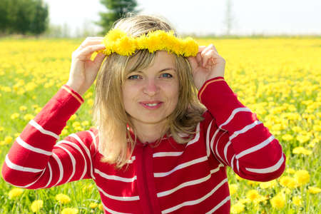 a smiling woman with a dandelion Crown photo