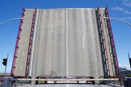 drawbridge: open drawbridge and closd barriers for the road traffic