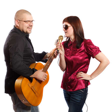 duet: couple playing guitar and sing on a white background
