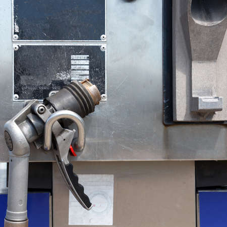 auto gas filling gun in lpg filling station photo
