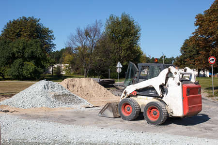 small excavator bobcat on the construction site photo
