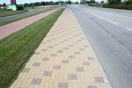 sideway: brick paved sideway at side of the street Stock Photo