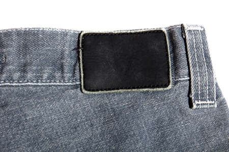 black leather label on gray jeans photo