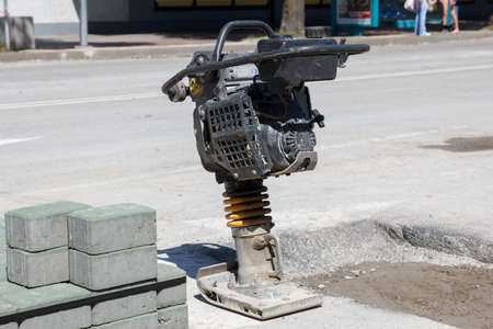 compacting: Trench Rammer on the street during the road repair Stock Photo