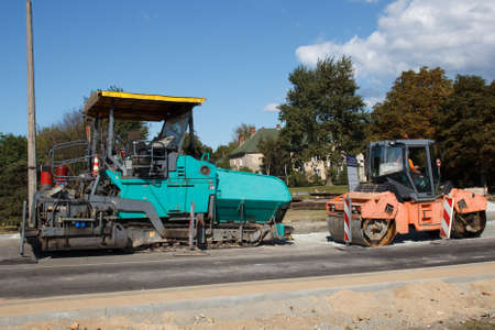 asphalt paving: A couple of Asphalt paving machines used in construction