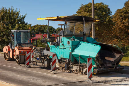 A couple of asphalt paving machines not working photo