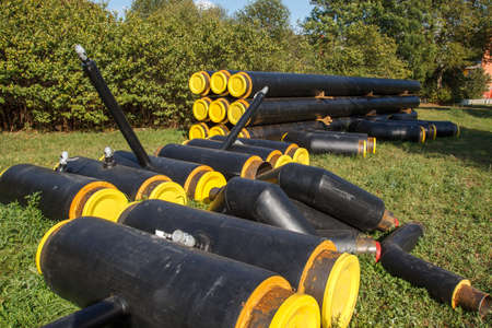 Some new yellow and black pipes that are going to be used for construction photo