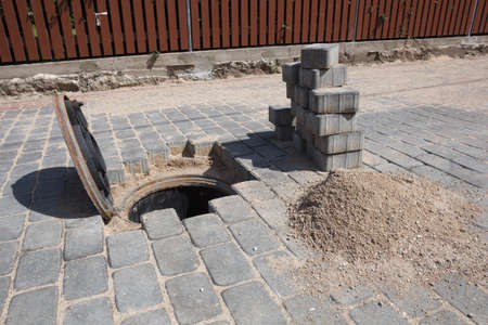 access point: A manhole cover for a sanitary sewer access point