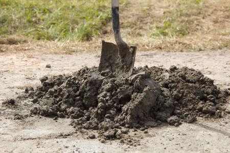 cement pile: A pile of cement with a shovel in it Stock Photo