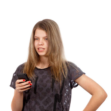 brown haired: A caucasian brown haired teenage girl on her phone Stock Photo
