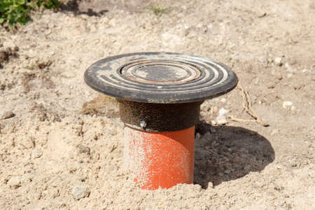 A orange sewer drainage pipe in a construction site photo