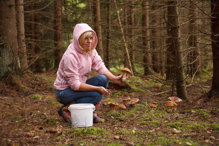 fungoid: A woman holding a mushroom in the forest