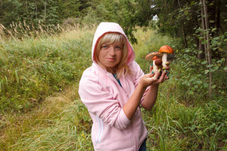 fungoid: A woman holding a bunch of mushrooms Stock Photo