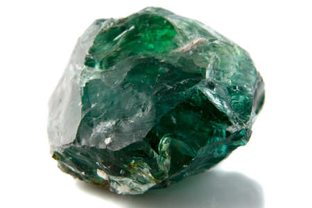mineralogy: A piece of green solid glass on white background Stock Photo