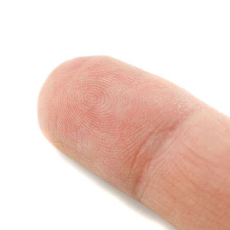 A tip of a finger with visable fingerprints
