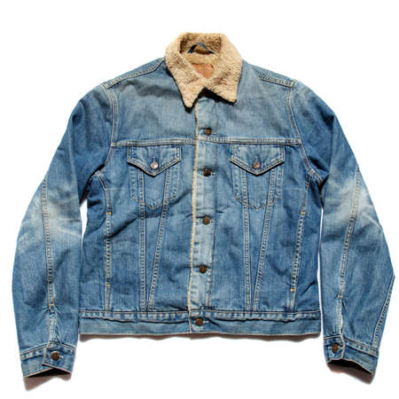 A cool vintage blue jean jacket on white background