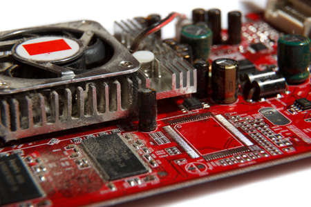computer component: A dusty red computer component on white background Stock Photo