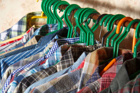 shirts on hangers: Variety of mens colorful shirts on Hangers Stock Photo