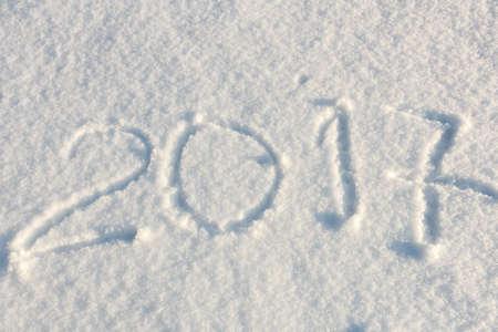 freshly fallen snow: handwritten new year  2017 in freshly fallen snow