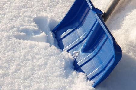 blu: A blu snow shovel on snowy background