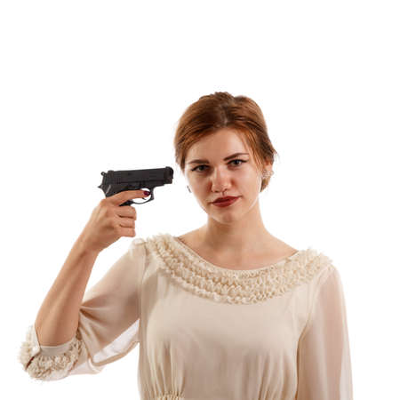 Lady pointing a gun at her head Stock Photo