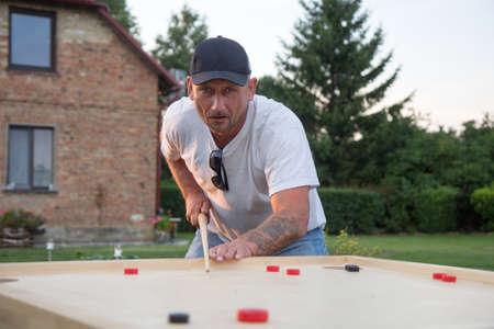 Man playing Novuss in outdoors Stock fotó - 121888531