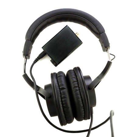 professional studio headphones and digital analog converter or DAC on white background