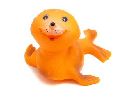 smiling seal toy on a white background