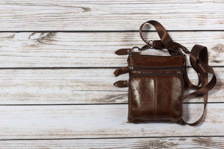 mens leather shoulder bag on wooden background