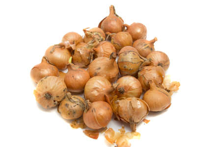 pile of natural onions with some small defects
