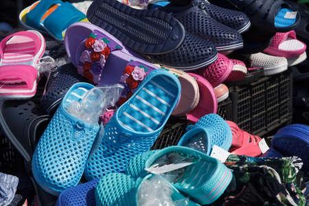Pile of shoes. Closedup of soes on sale in a flea market.