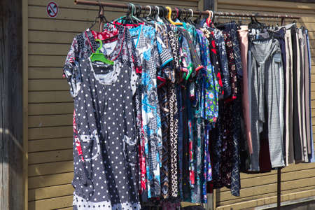 various clothing hung in sale on flea market Stock Photo