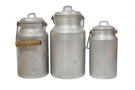 three retro aluminium milk cans on white background