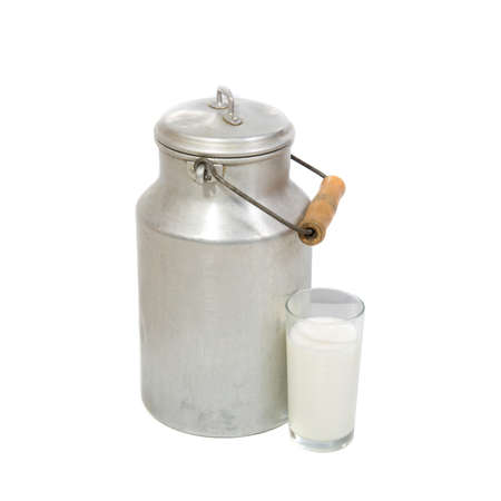Glass of fresh milk and retro milk canister on white background