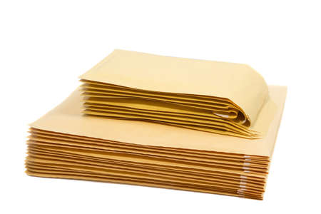 Stack of padded mailing envelopes isolated against a white background
