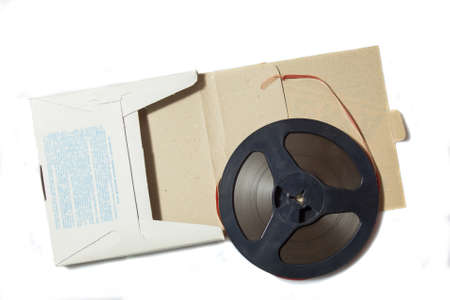 Vintage magnetic audio tape, reel to reel type, paper box on the white background