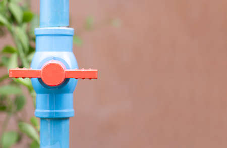 Blue water valve connected to the PVC pipe with copy space, Selective focus on the water valve.