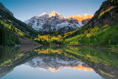 alps: Sunrise at Maroon bells lake Stock Photo