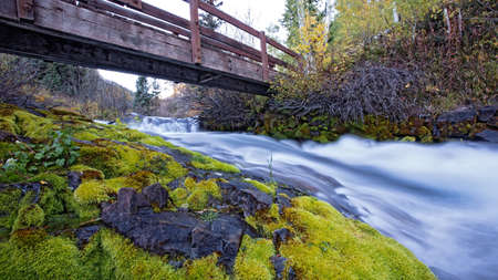 woden: woden bridge over mountain river, Aspen Stock Photo