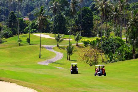 Golf cars on the golf course, Samui 스톡 콘텐츠
