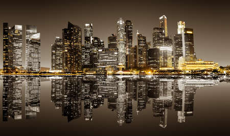 Panoramic night view of Singapore bussines district in sepia colors