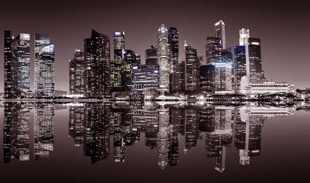 urban scene: Panoramic night view of Singapore bussines district in sepia colors