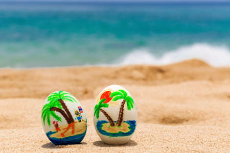 Easter eggs, painted with palms on the ocean beach