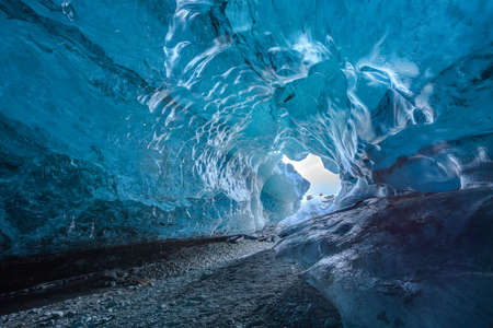 Inside an ice cave in Vatnajokull, Iceland. The ice is thousands of years old and so packed it is harder than steel and crystal clear.