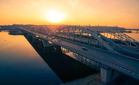 dnepr: Darnitskiy bridge across Dnepr river against sunset sky. Kiev, Ukraine Stock Photo