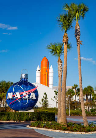 Cape Canaveral, Florida, USA - DEC, 2016: Nasa globe in front of Atlantis space shuttle rocket.