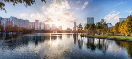lake district: Sunset at Orlando in Lake Eola Park with water fountain and city skyline, Florida, USA